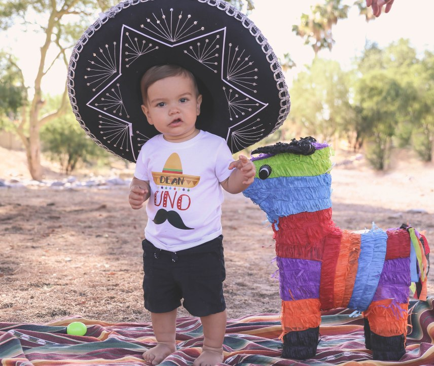 one year old boy in a sombrero with a colorful pinata family birthday toddler baby photography aribella photography