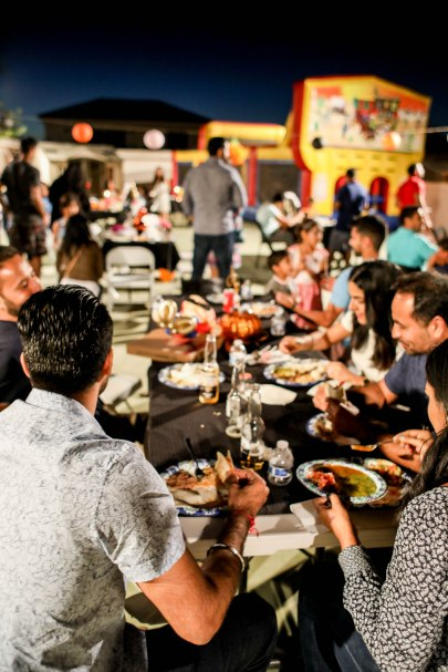 groups of people at black tables eating mexican food aribella photography event pictures