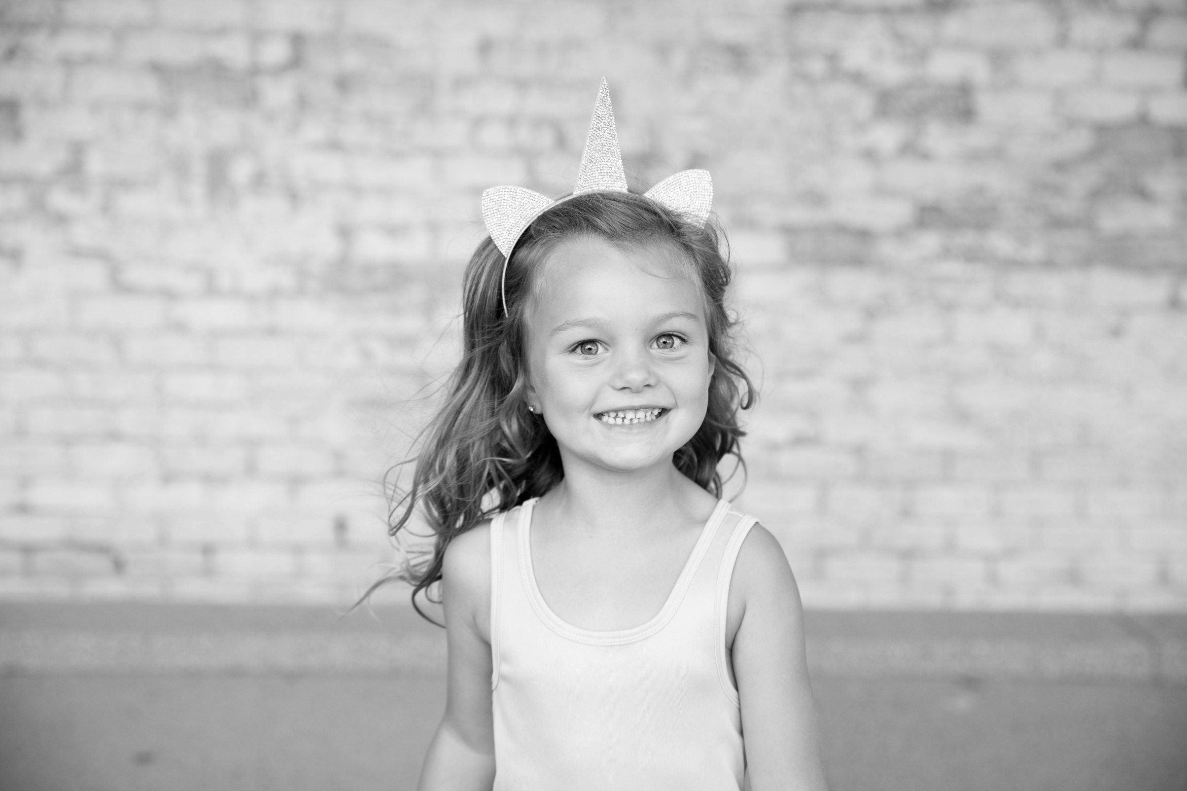 black and white picture of little girl with unicorn headband kids children family picture aribella photography