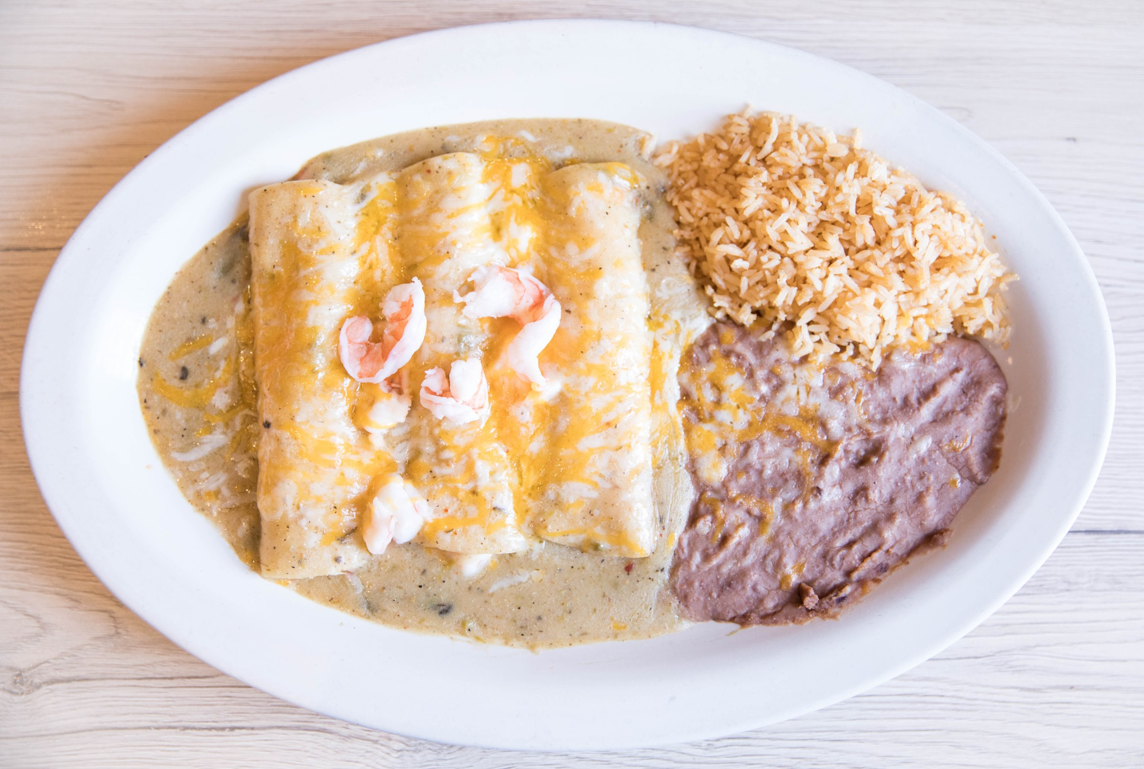 white oval plate enchiladas beans rice aribella photography food pictures