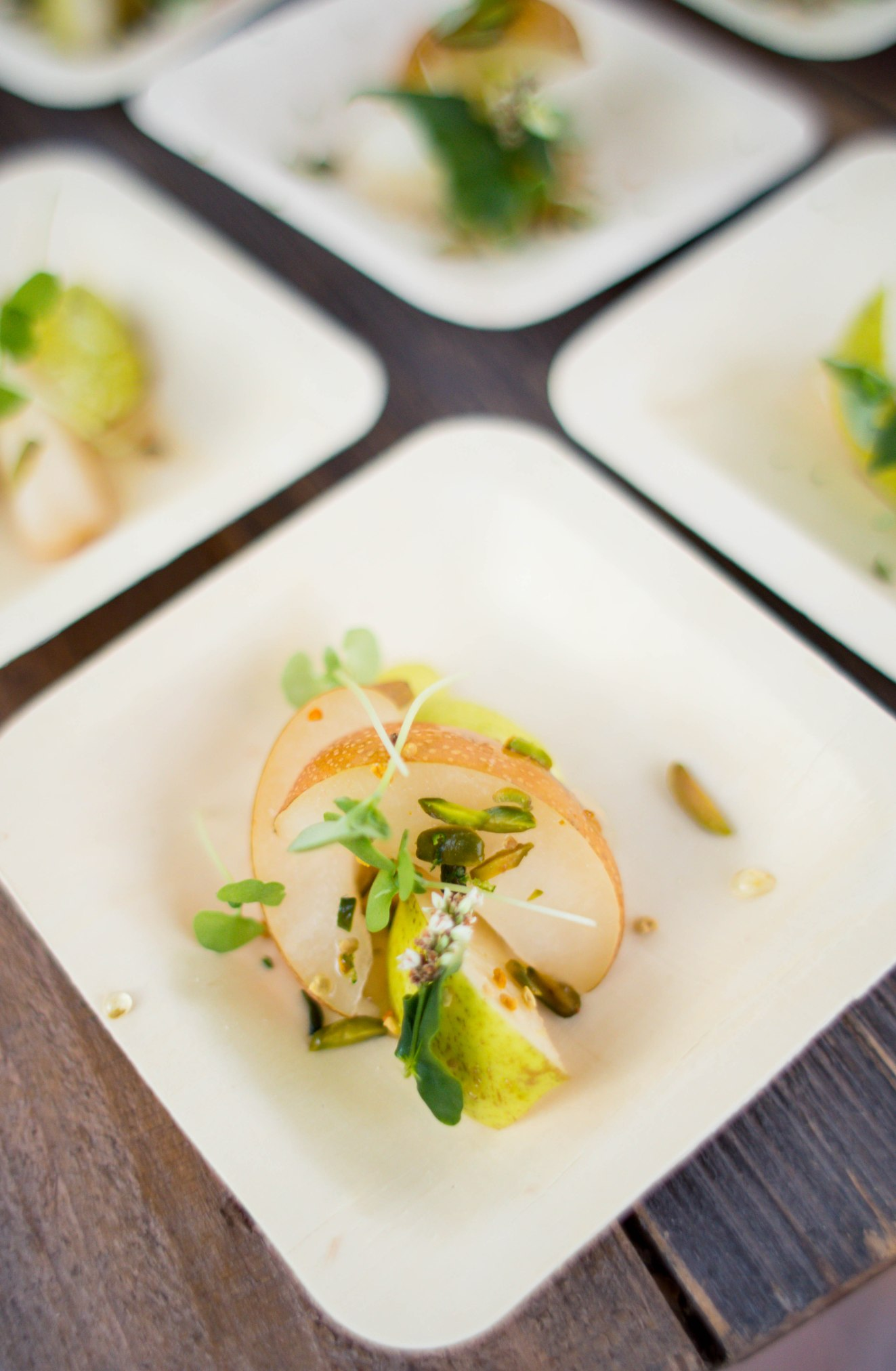small square plates with pears and greens aribella photography food pictures