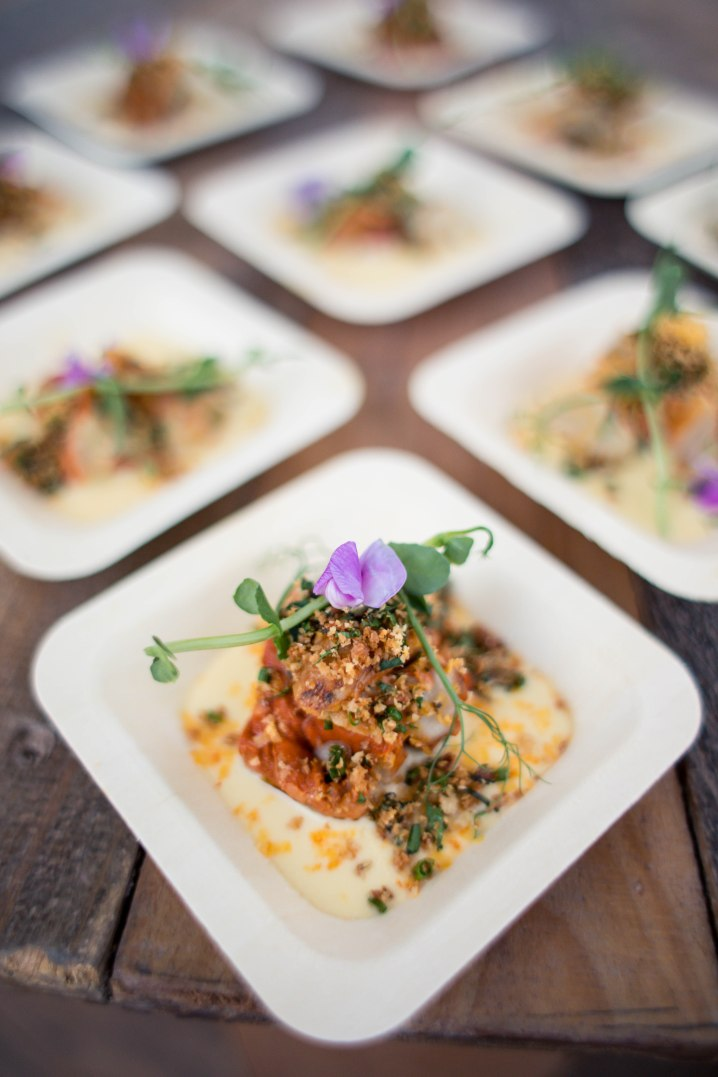 small square plates of food with sweet pea flowers on top aribella photography food pictures