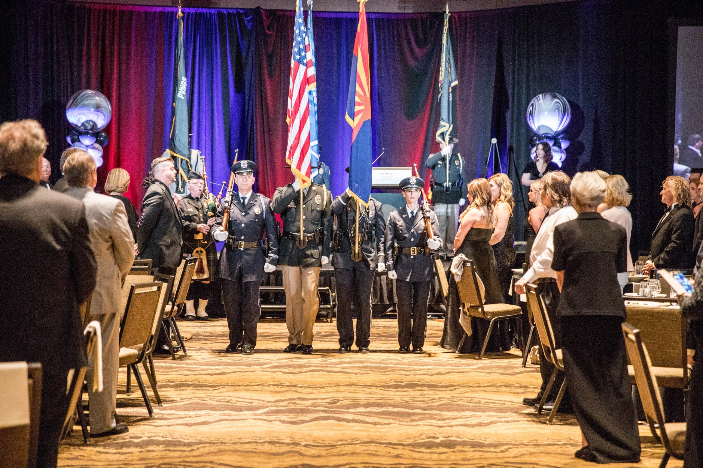 four men and women in color guard stand at attention at a event aribella photography event pictures