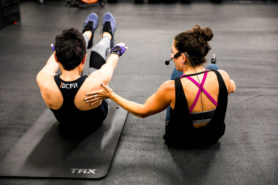 two brunette women workout on the gym floor instructor head shot profile picture photography branding brand brands aribella photography