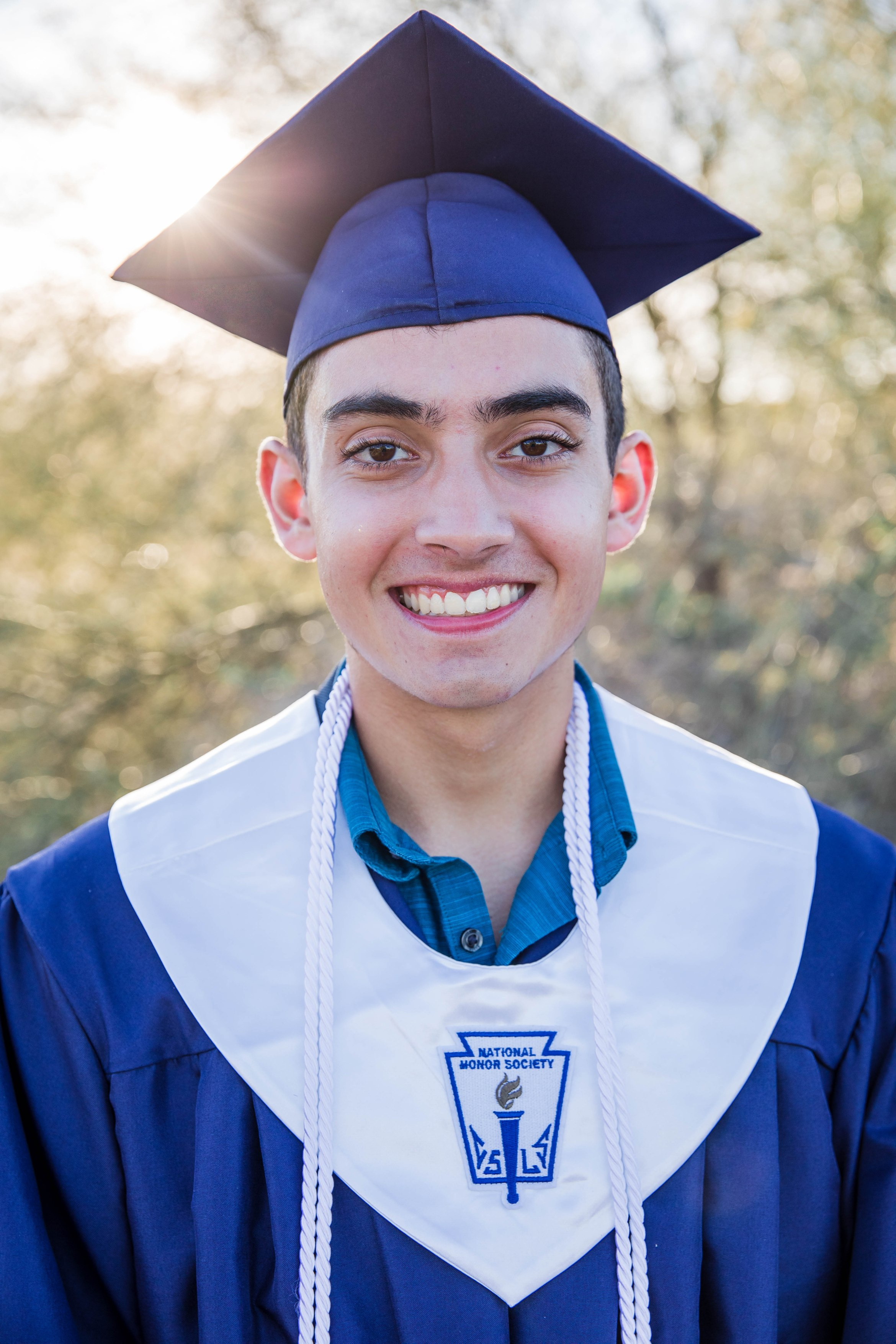 young man in blue cap and gown senior picture family teen kids children picture family aribella photography