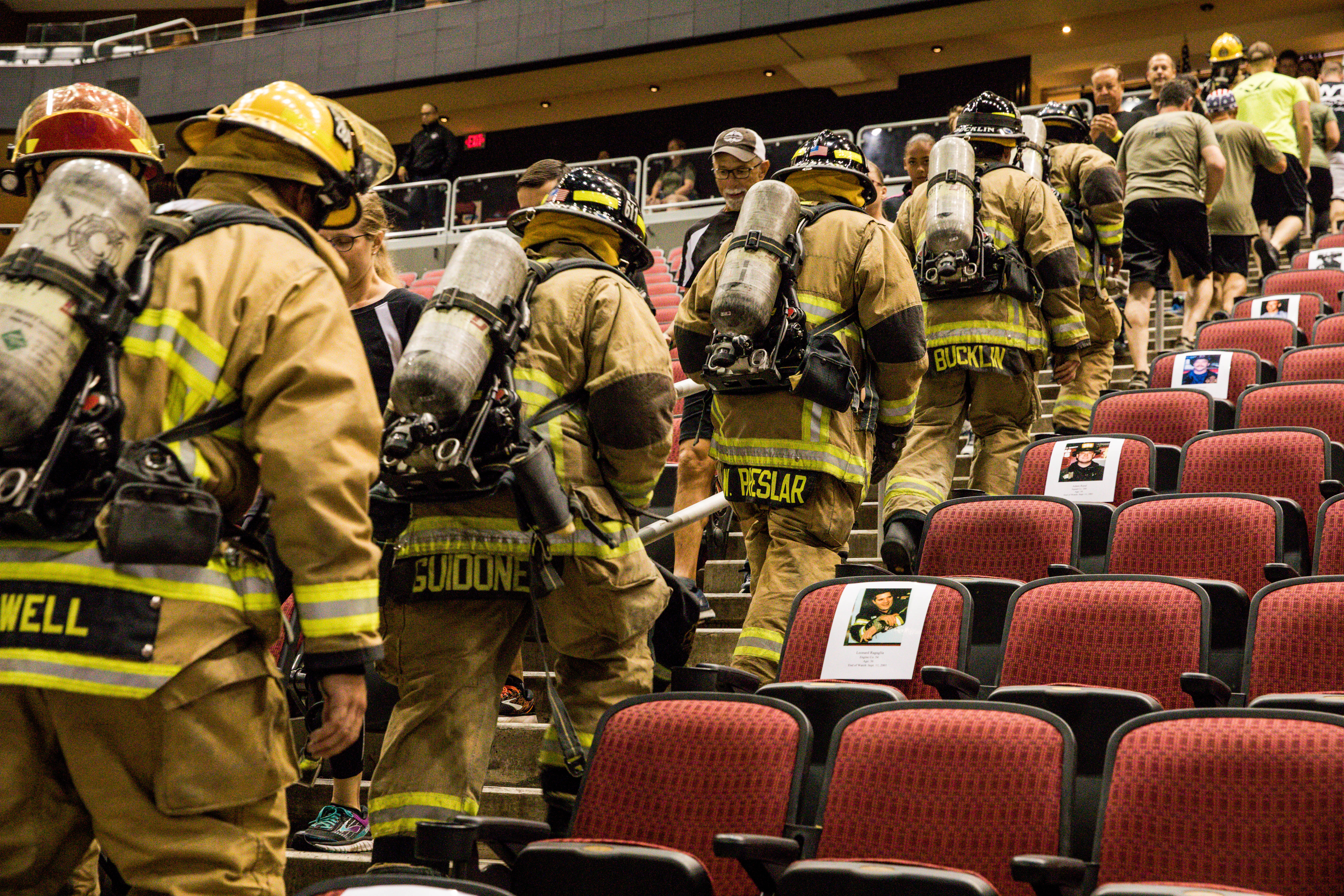Firemen in full uniform and gear walk up stairs in line aribella photography event pictures