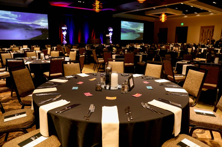 large event room with circular tables with black and white table cloths aribella photography event pictures
