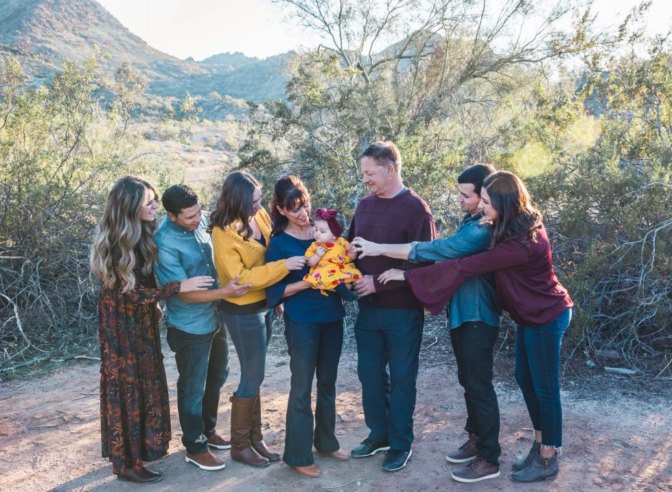 family of adults look at grandparents holding grand daughter aribella photography family kids children pictures photos