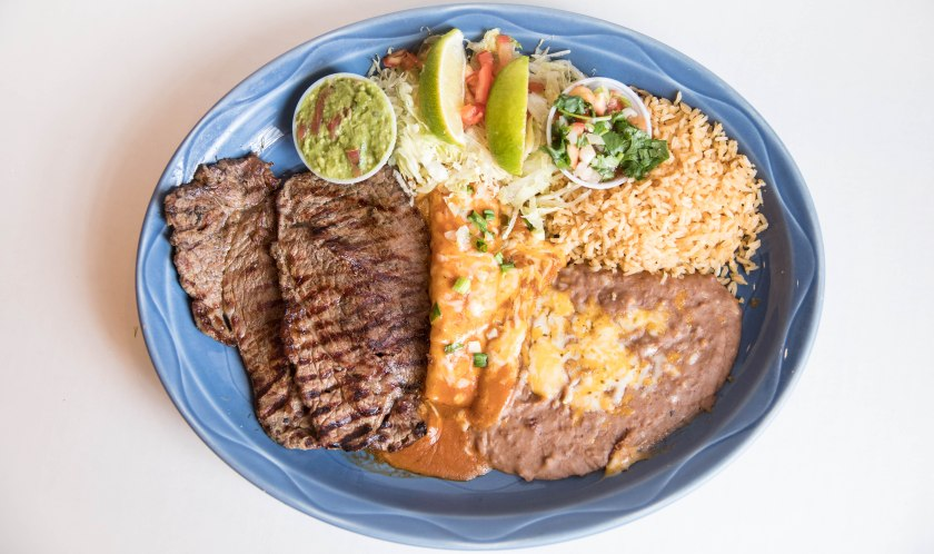 blue oval plate with steak enchiladas rice and beans aribella photography food pictures
