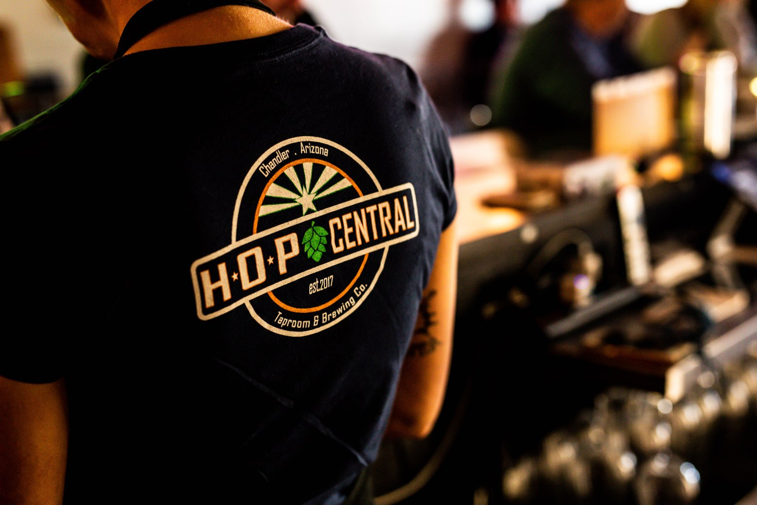woman wearing black shirt with HOP Central logo on back aribella photography brand branding photography