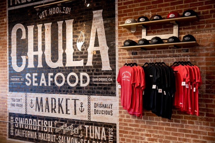 brick wall painted with Chula Seafood logo and merchandise aribella photography pictures branding brand photography